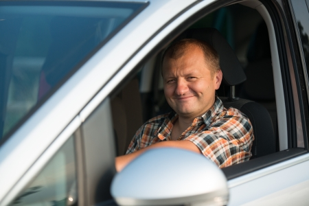 happy young man driving a car and smiling Stock Photo - 17490497