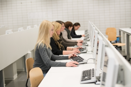 young women working with personal computers in office or in university Banco de Imagens
