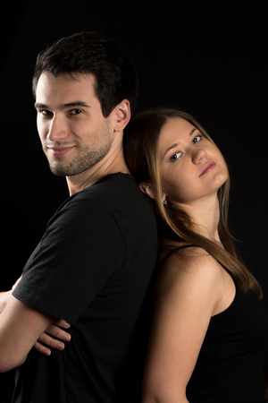 young girl nude: Young couple, man and woman on the black background