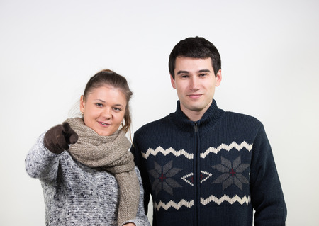 amigos abrazandose: portraits of young couple, man and woman, wearing winter clothes