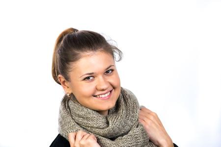 ni�as sonriendo: Retrato de ni�a bonita, con bufanda Foto de archivo