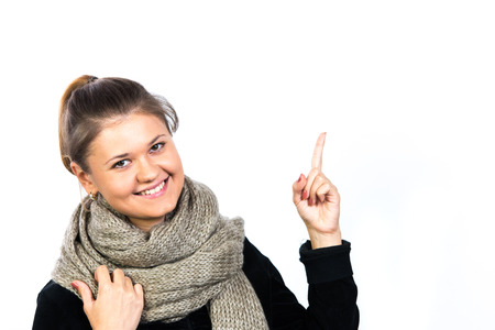 cute lady: portrait of pretty girl, wearing scarf and pointing with her finger