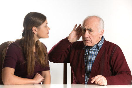 young woman makes hearing test for old senior man Banco de Imagens