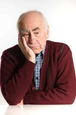 old senior man having problems, thinking, beeing serious