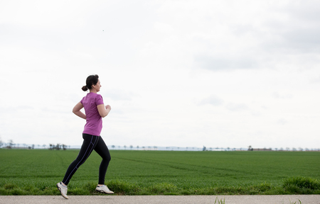 40 years old: 40 years old woman jogging (running) outside