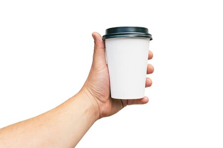 Isolated Takeaway cup, for Coffee, Tea in a guy s hand with a black cap, on a white background. Takeaway food concept. Stok Fotoğraf