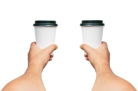Isolated Takeaway cup for Coffee, Tea in a guy s hands with a black cap. on a white background Stok Fotoğraf