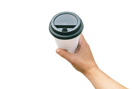 Isolated Takeaway cup, for Coffee, Tea in a guy s hand with a black cap. on a white background Stok Fotoğraf