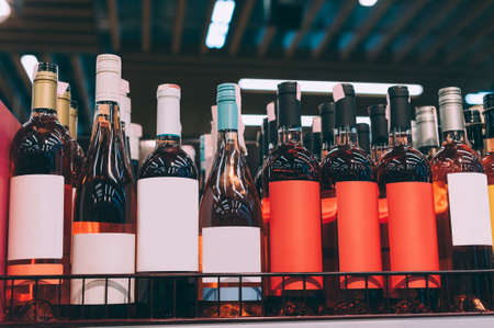 Mockups of glass bottles with rose wine on a supermarket counter