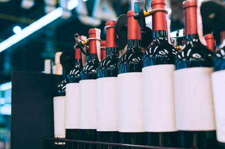 Mockups of glass bottles with wine on a supermarket counter