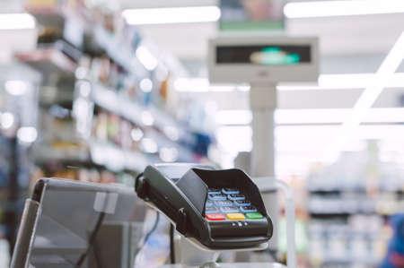 Cash machine. On the background of showcases of supermarket showcases Standard-Bild
