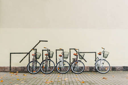Bicycles on the background of a light wall