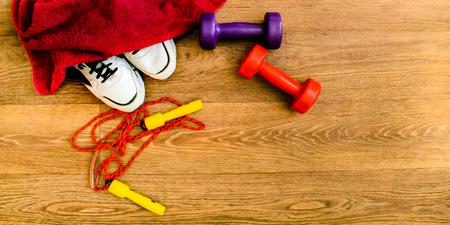 sport equipment, rope, fitness, sports, towel, sneakers, wooden floor, running shoes, sports dumbbells, sport stuff Stock Photo