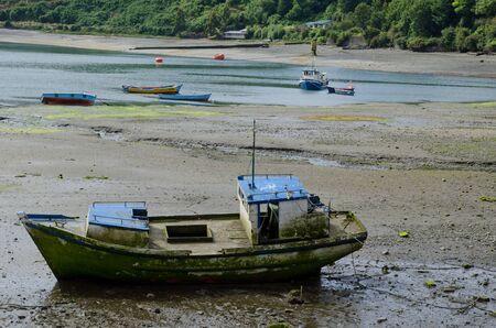 Fishing boat stranded in the coast. Angelmo. Puerto Montt. Los Lagos Region. Chile. Archivio Fotografico