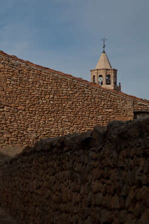 Stone walls and tower of a church. 스톡 콘텐츠