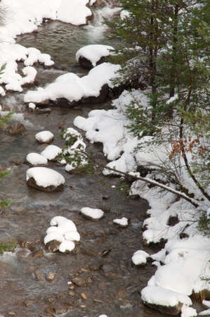 Sia River with its snow-covered banks in the Pyrenees. Banco de Imagens