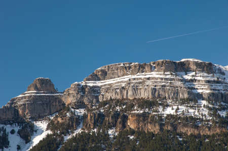 Airplane flying over Las Sestrales in Ordesa and Monte Perdido National Park.