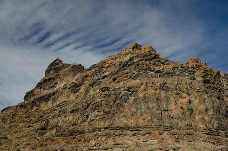 Rocky cliff in the Special Natural Reserve of Guigui. Aldea de San Nicolas de Tolentino. Gran Canaria. Canary Islands. Spain.