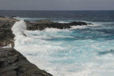 Waves breaking on the coast. Las Salinas. Arucas. Gran Canaria. Canary Islands. Spain.