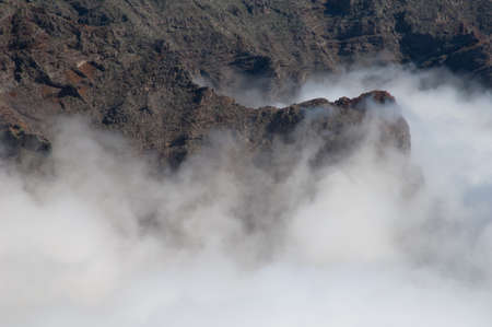 Cliffs of a volcanic crater and sea of clouds. Caldera de Taburiente National Park. The Palm. Canary Islands. Spain. Archivio Fotografico