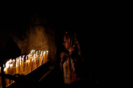 church of the holy sepulchre: Young Woman Praying
