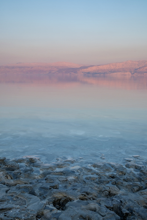 Lanscape of the dead Sea in Israel. In the Background, the mountains turn purple red because of the sunset light