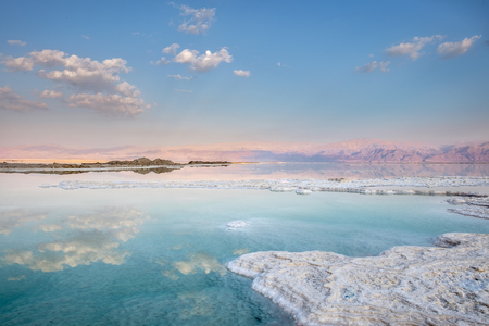 Landscape of the Dead Sea in Israel. By sunset, the Jordan mountains on the other side, turn purple red