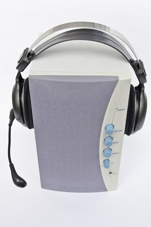 multimedia active speaker system and headset on it over light background Stock Photo - 11072259