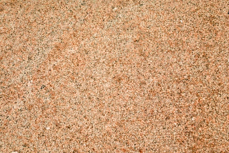 exasperate: an exasperate unpolished grainy pink granite background