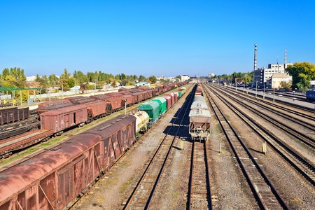 boxcar train: a perspective view of station with set of parallel rail lines with waggons