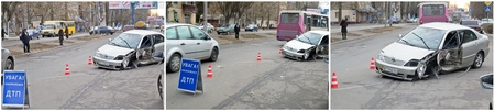 A road accident happened  in Ukrainian Kherson on December 12, 2011. A driver in a car failed to keep moving straight and was caught in by billboard pole and lost front left wheel and severely damaged the car. Fortunately, theres been no casualties thank