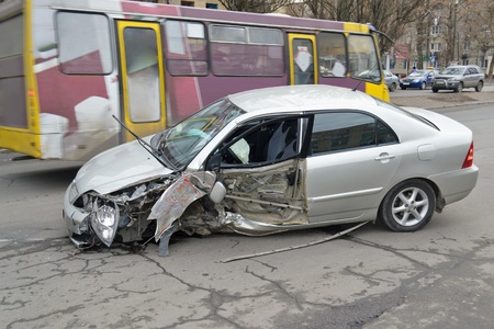 A crashed car as a result of a street road accident photo