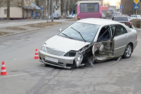 damages: A crashed car as a result of a street road accident