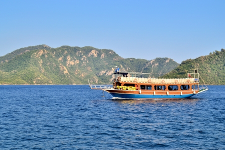 pleasure craft: Turkish houseboat with tourists at a popular Mediterranean resort Marmaris Stock Photo