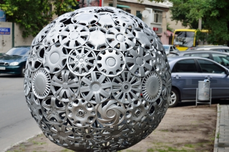 KHERSON, UKRAINE - AUG 27  close view of advertising ball made of hubcaps near tire repair shop of official Hyundai and KIA service station taken on August 27, 2013 in Kherson, Ukraine