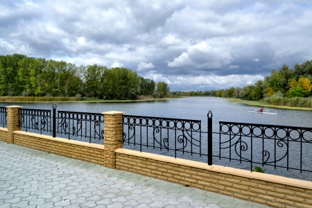 poplar  banks: a stone tiled walkway quay at Dnieper river bank in the vicinity of Kherson in Southern part of Ukraine Stock Photo