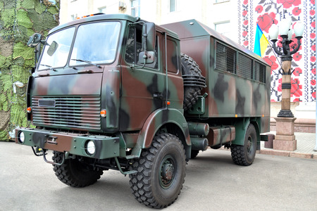 motor cop: police and military camouflaged service truck for transportation of staff Editorial