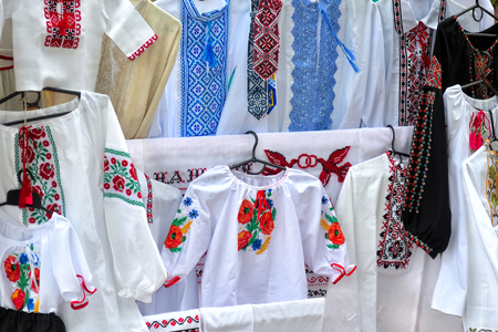 handiwork: traditional national Ukrainian handiwork embroidered and decorated shirts, dresses and towels popular nowadays in Ukraine as manifestation of national authentication and as just a modish style