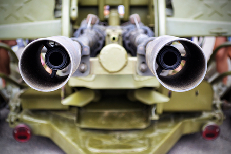 a close view of double muzzles edge of artillery weapon unit Stok Fotoğraf - 64484338