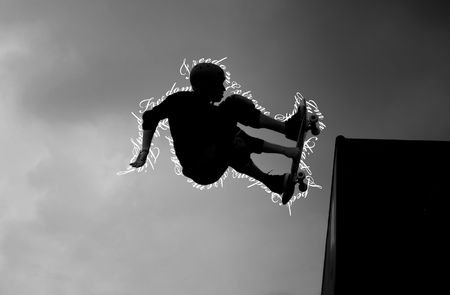 Skateboarder doing trick and feeling freedom photo