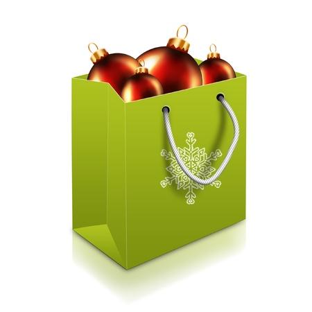 白い背景で隔離のグリーン クリスマス バッグとボール