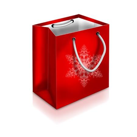 白い背景で隔離赤いクリスマス バッグとスノーフレーク 写真素材