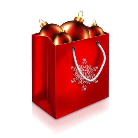 白い背景で隔離の赤クリスマス バッグと赤いボール