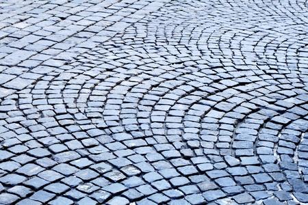 sidewalks: paving stone pavement consisting of gray stones Illustration