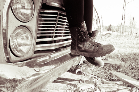 Boots on Antique Car Imagens