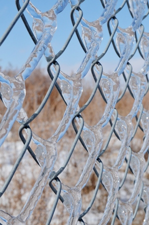 chainlink fence: Ice on Chainlink Fence Stock Photo