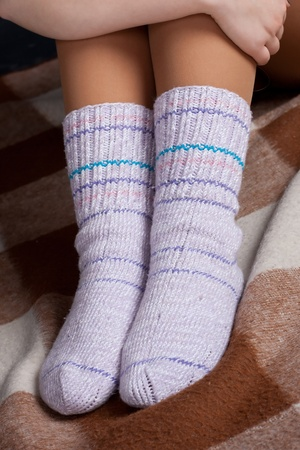 knitted socks on his feet Stock Photo