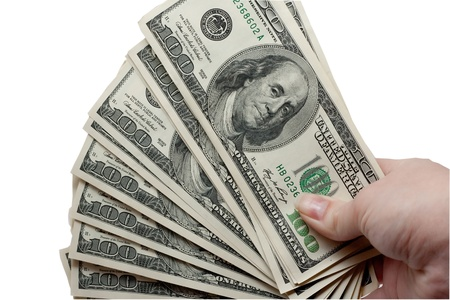 a bundle of money in hand on white background