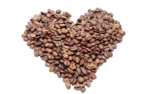 Heart of coffee beans on white background