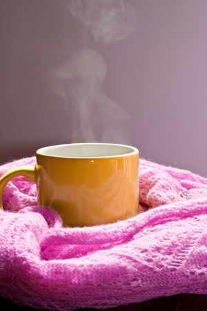 cup with steam in the scarf